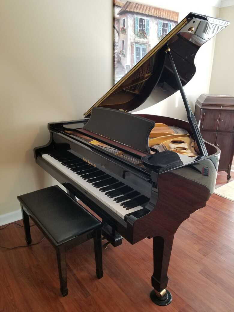 Glossy black baby grand piano