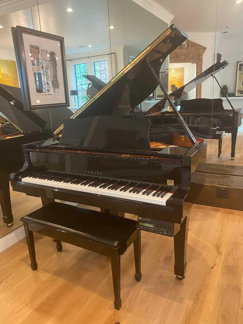 Beautiful Yamaha grand piano in ebony color. Model c2