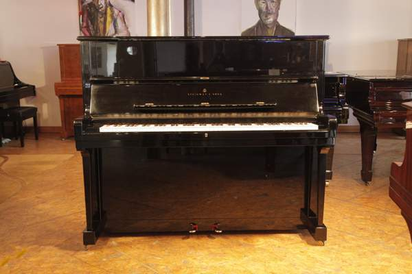 A 1985, Steinway Model V upright piano with a black case