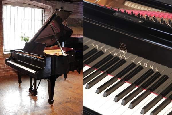 Rebuilt, 1923, Steinway Model O grand piano with a black cas