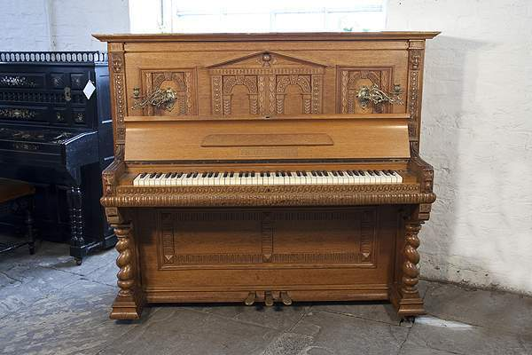 Romanesque style, Helmholz upright piano in carvedoak