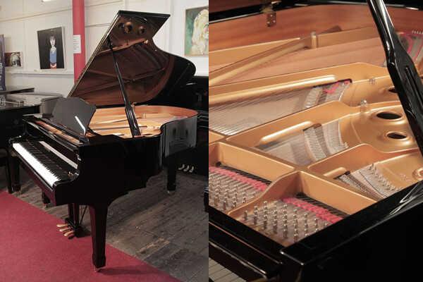 A 2002, Yamaha C3 grand piano in black