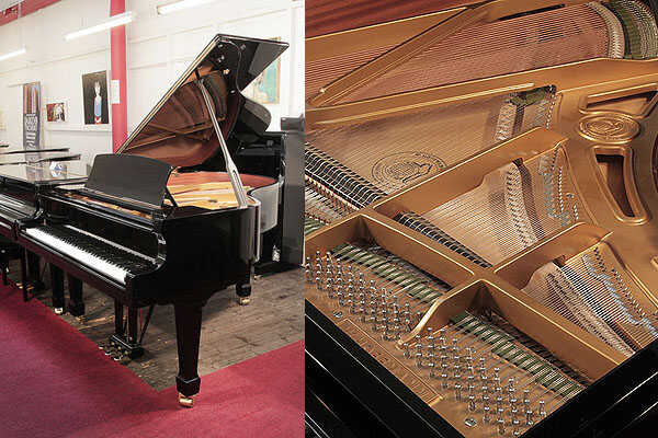 A 2016, W. Hoffmann T177 grand piano with a black case