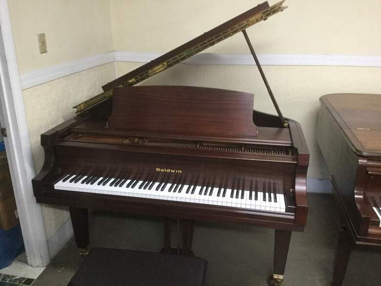 """New"" Baldwin M1 Artist series grand piano"